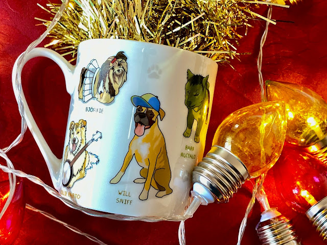 A mug with dogs with props and names like Will Sniff