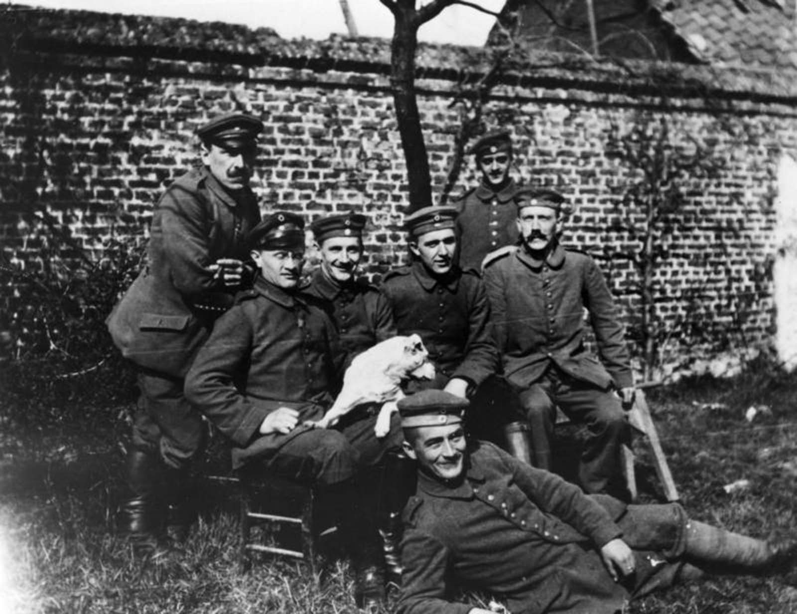 Hitler sitting at far right among soldiers of the