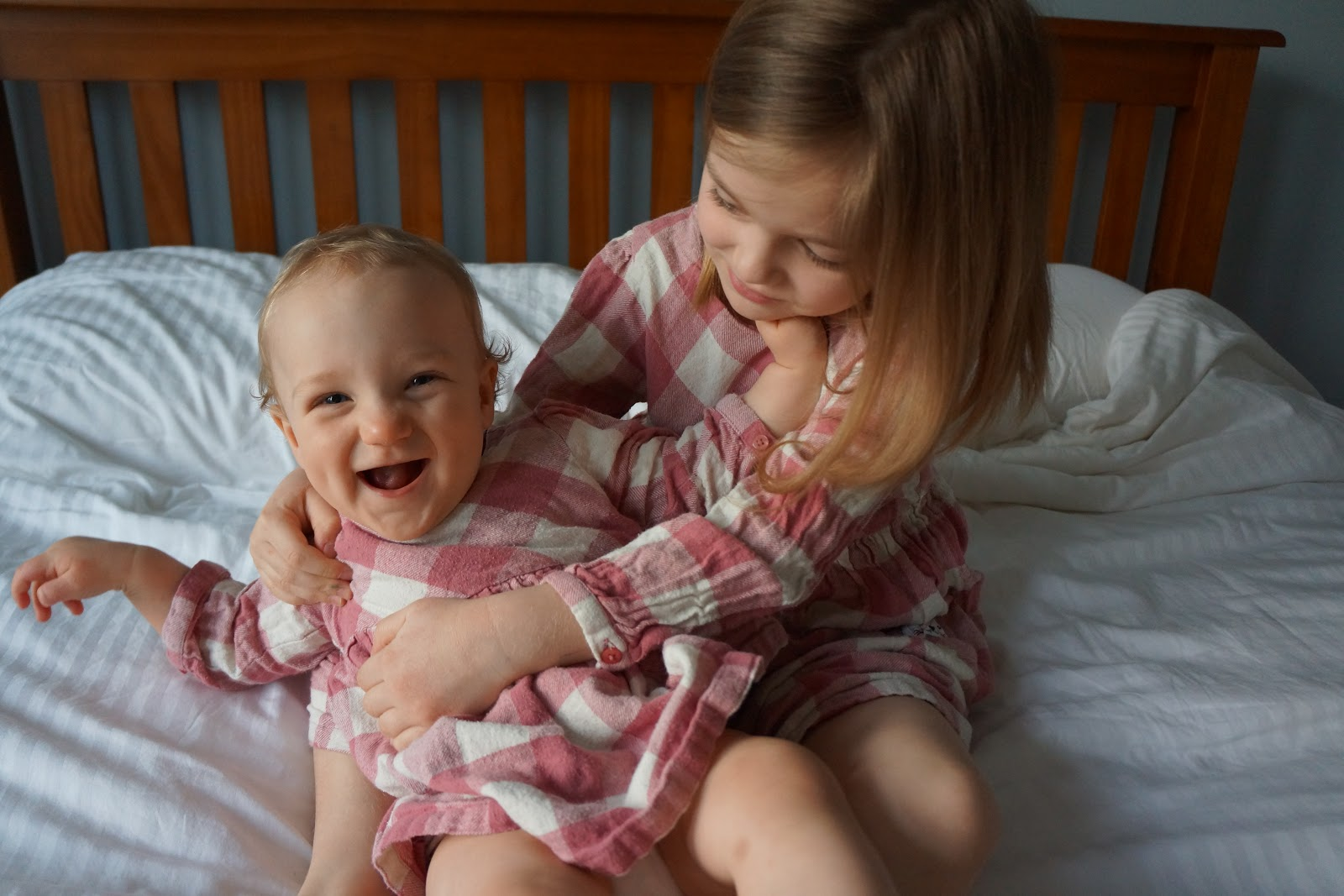 baby and sister in matching dresses