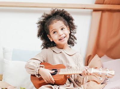 Girl holding an 'ukulele