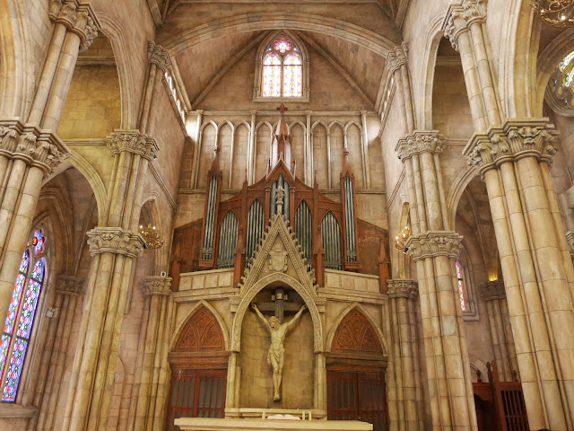 crucifix and pipe organ