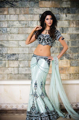 Gorgeous Indian Model Girl Poses In Sky And Royal Blue Bridal Lehenga Choli.