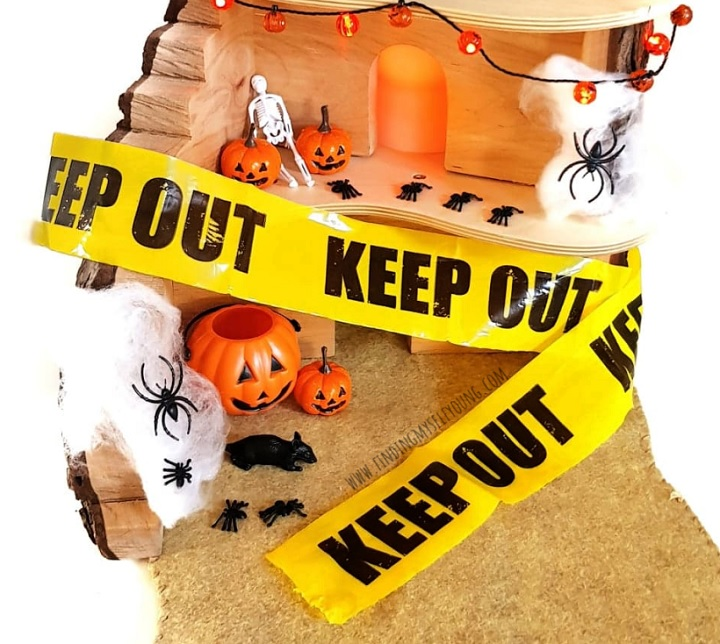 halloween haunted play house wrapped in keep out tape