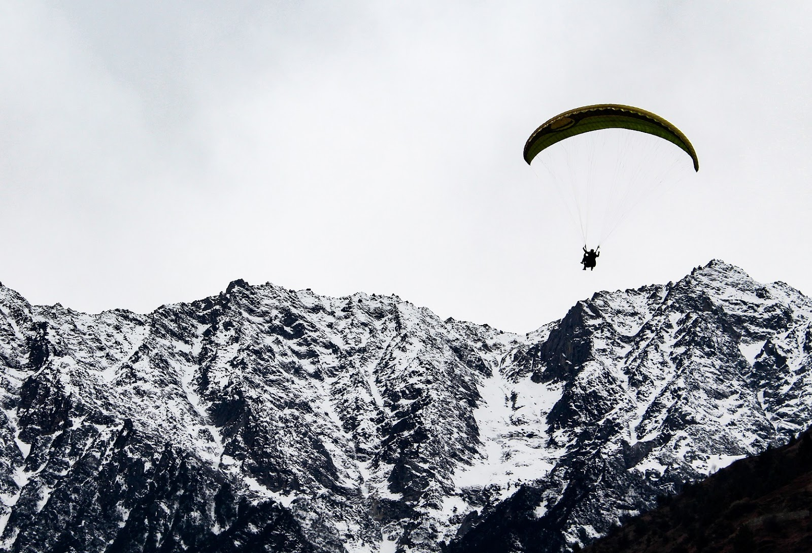 Paragliding at Solang the adventure valley amidst snow covered mountains