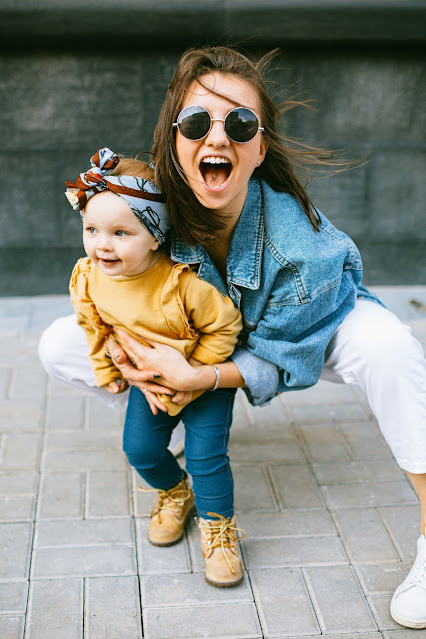 a mom keeping her kid stylish in a modern outfit