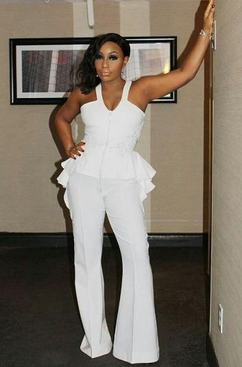 rita dominic in white jumpsuit