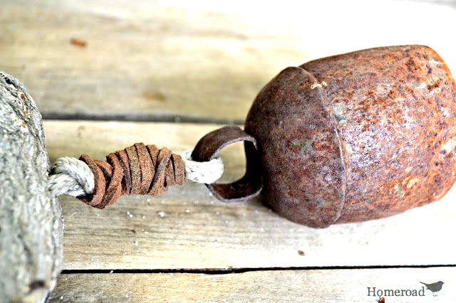 Rusty bell on wind chime