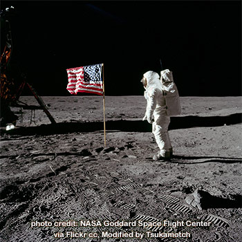Buzz Aldrin salutes the U.S. Flag photo credit by NASA Goddard Space Flight Center