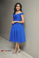 Actress Ritu Varma Pos in Blue Short Dress at Keshava Telugu Movie Audio Launch .COM 0018.jpg