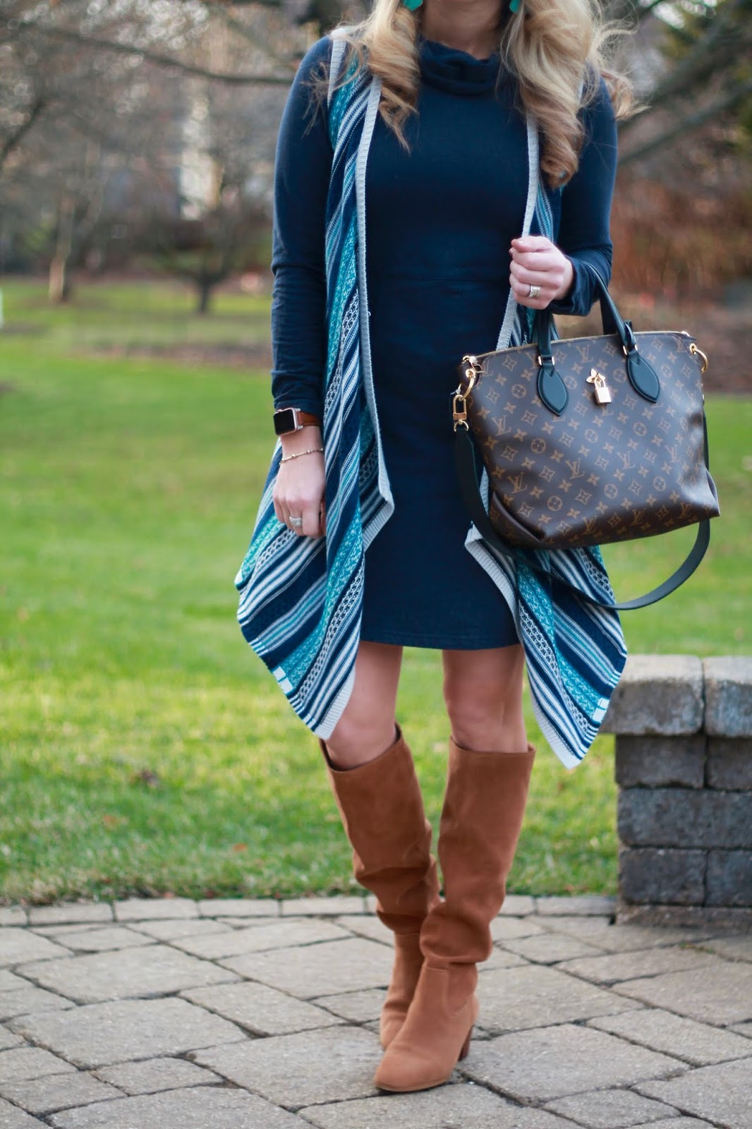 navy cowl neck dress, waterfall aztec vest, cognac suede boots, LV flowered tote, JORD apple watch strap
