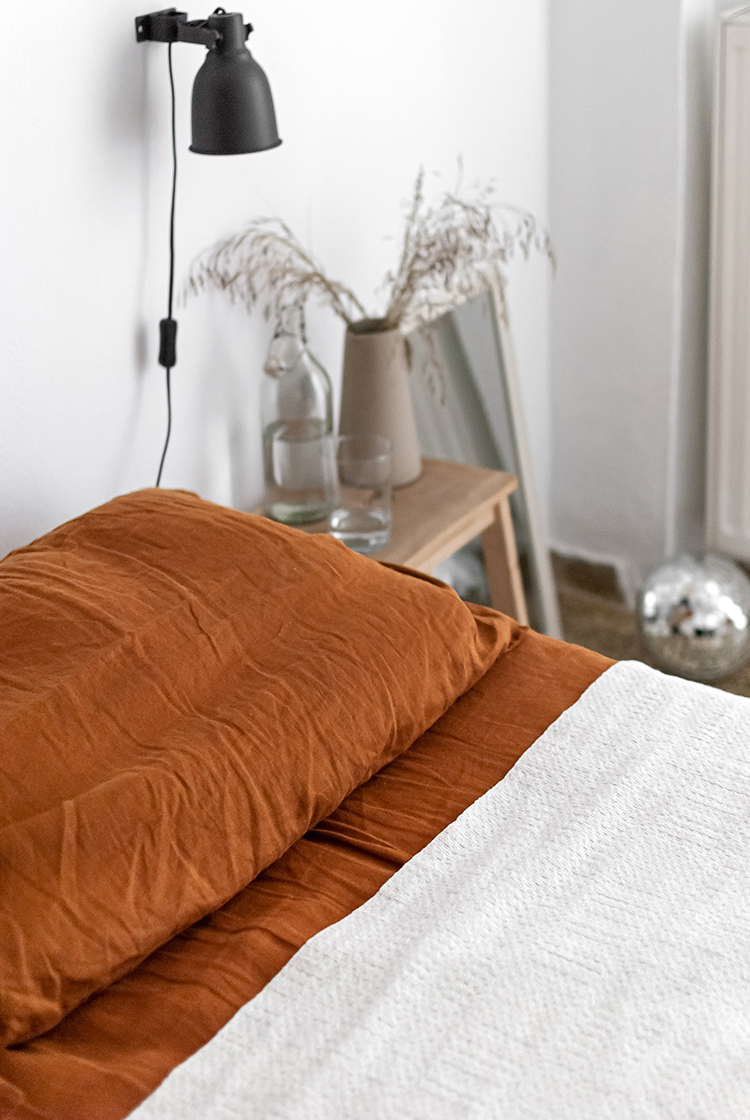 Cozy bedroom with burnt orange linen bedding. Styling and photography by Eleni Psyllaki for My Paradissi
