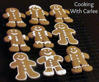 German gingerbread cookie men decorated with white royal icing on cooling rack