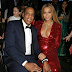 Beyonce slips into sexy red dress as she cosies up to Jay-Z at the GRAMMYs 2017