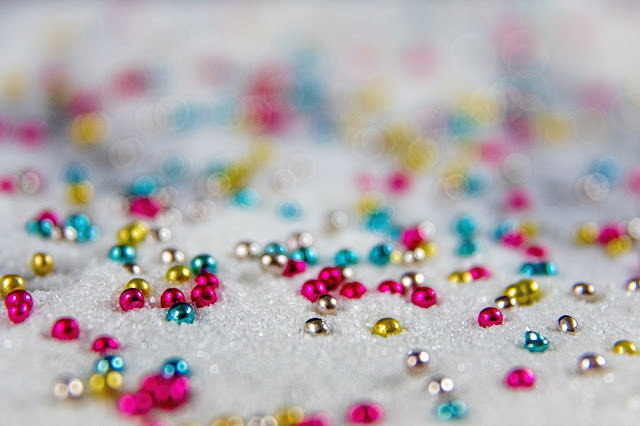 Scattered colorful beads.