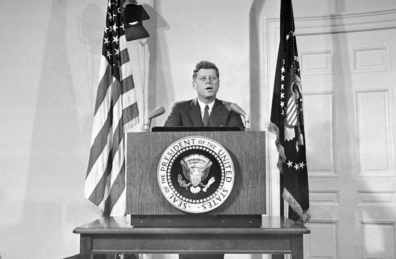 President John Kennedy reports personally to the nation on the status of the Cuban crisis, telling the American people that Soviet missile bases in Cuba are