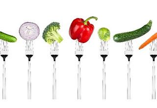 Variety of vegetables on forks