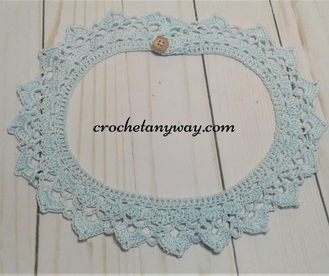 completed crochet collar with button in blue cotton crochet thread
