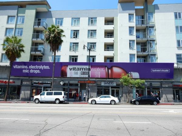 Vitamins Electrolytes Mic drops Vitamin Water billboard