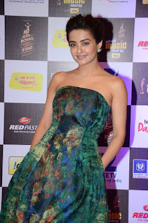 Surveen Chawla looks so cute and naughty in a Shoulder less Dress at Mirchi Music Awards 2016