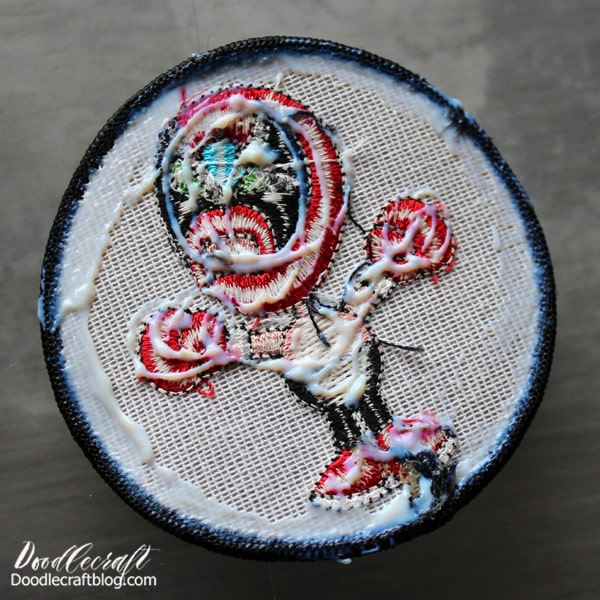 Just squeeze a bead of Fabric Fuse around the back edge of the patch and a little in the middle. Then press onto the jacket. Set a book on top while it dries to keep the edges firmly down.  Let it dry for a few hours or overnight to be safe. This glue is also permanent through washing!