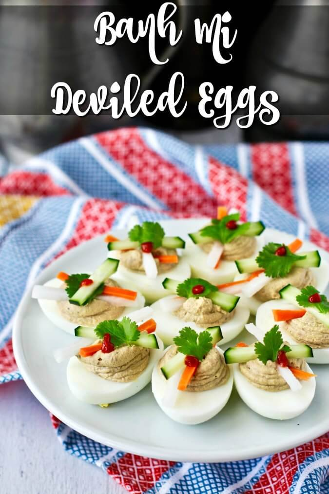 Banh Mi Deviled Eggs with pickled daikon radish and carrots garnished with cucumber, cilantro, and Sriracha