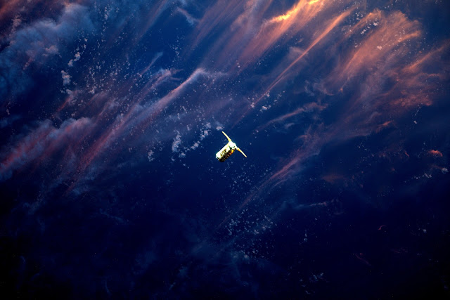 Cygnus Spacecraft seen from the International Space Station at Sunset