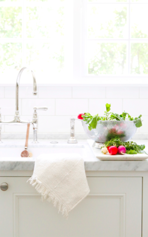 Gorgeous white farm sink in Erin Fetherston's kitchen on Hello Lovely