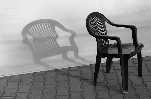 A Series of 3 Black and White Minimal Art Photographs of a Plastic Chair and its shadow captured at Jawahar Kala Kendra, Jaipur, India.
