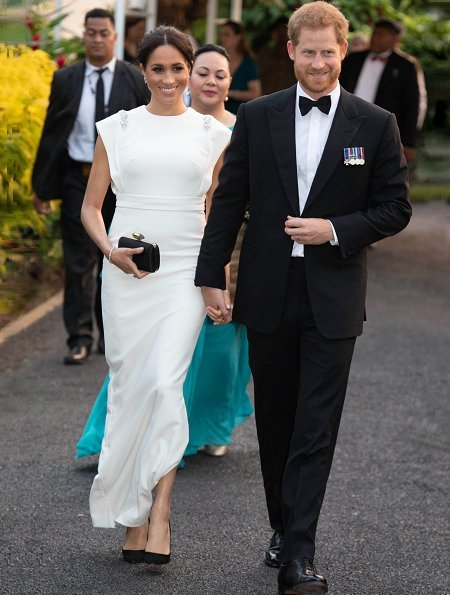 Meghan Markle wore THEIA ivory cap sleeve beaded shoulder gown, Birks snowflake snowstorm diamond earrings and carried Givenchy satin clutch