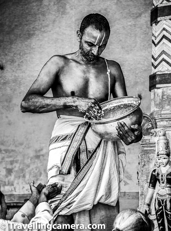 Portraits become more meaningful when humans in action are clicked and especially real action. Above photograph shows a priest distributing prasadam in a temple and one of the visitor extending his hands towards the priest to take blessings in terms of curd-rice prasadam.     At home, you can try clicking photograph of your parents reading newspapers while enjoying their morning tea.