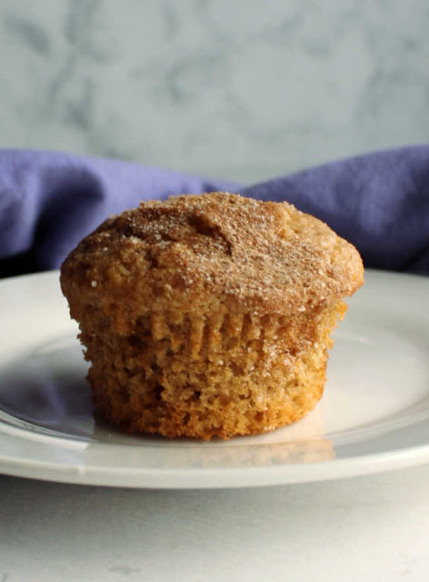 close up of cinnamon brown sugar muffin with wrapper removed