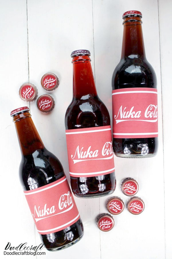 Simply print off these Nuka Cola labels and tape them on, don't forget to add a Nuka Cola Sticker to the top of the bottle caps too!   Hmm, I think that middle one looks more like Nuka Cherry! Make all the variations you want!