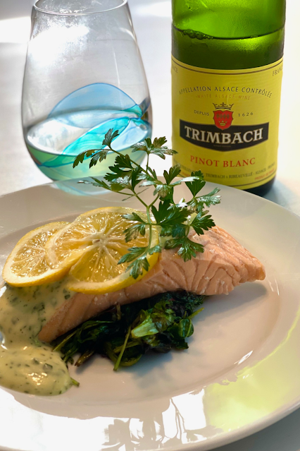 Poached salmon served with green herbed mayonnaise
