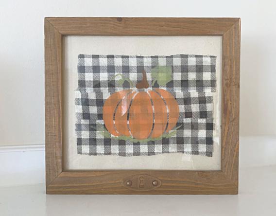 stenciled pumpkin under glass