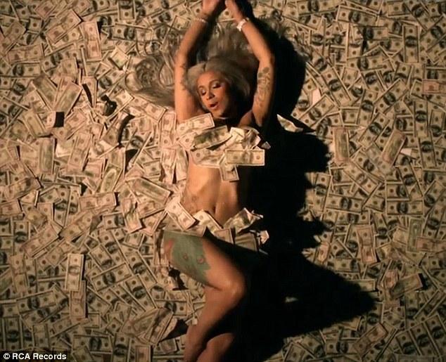 Money moves! Cardi B rolls around naked on pile of money,makes history