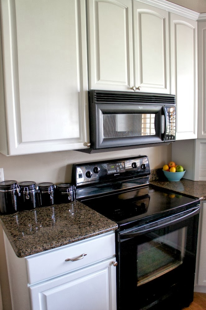 kitchen with black appliances contemporary just love these white cabinets that were painted by www utahpaintpro com how my black what color to paint kitchen with and