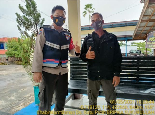Polsek Murung Sosialisasikan Prokes Dan Bagikan Masker Ke Warga Desa Batu Putih