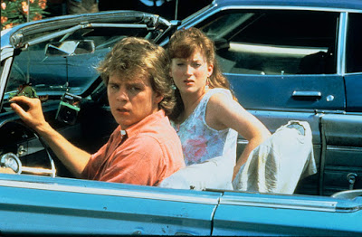 A Nightmare on Elm Street 2: Freddy's Revenge movie still featuring Mark Patton and Kim Myers in a classic car