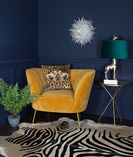 Navy room with statement ochre colour chair