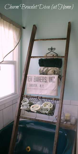 rustic wood ladder bathroom tub wire basket towel