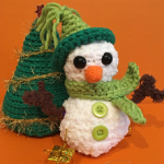 http://www.ravelry.com/patterns/library/christmas-scene-snowman-and-tree
