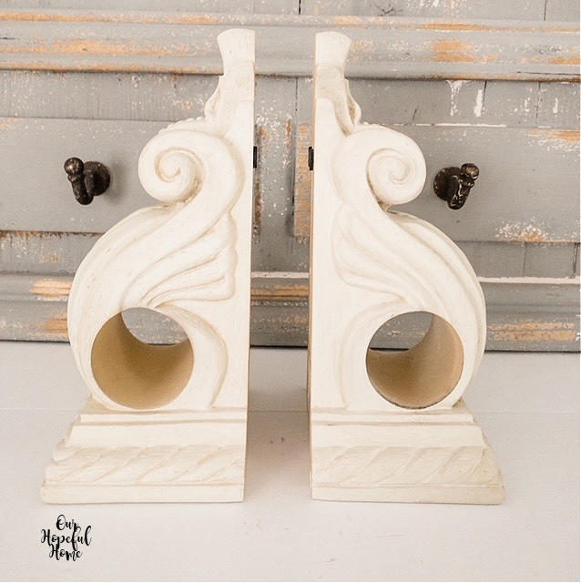 pair ornate cream drapery sconces