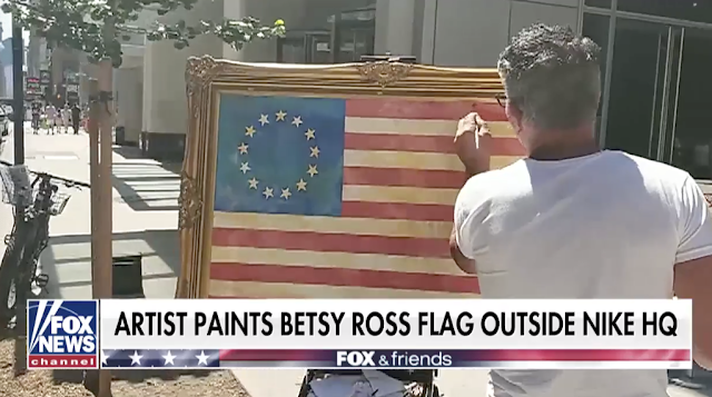 Artist paints Betsy Ross flag outside Nike headquarters in NYC