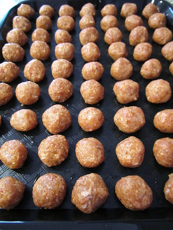 A tray of small meatballs ready to go into the soup