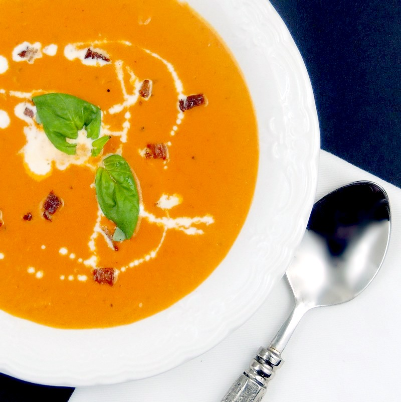 This Tomato Bisque with Bacon and Basil recipe is so rich and creamy you will want to eat the whole pot! #tomato #bacon #basil #soup #bisque #easy #recipe | bobbiskozykitchen.com