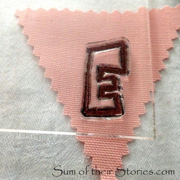 stamping letters for a mini bunting card