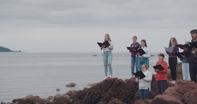 Members of National Youth Choir of Scotland on the isle of Cumbrae