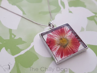Craft Tutorial: How to press flowers and make a simple resin pendant necklace.