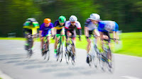Bike racers in a race by Markus Spiske