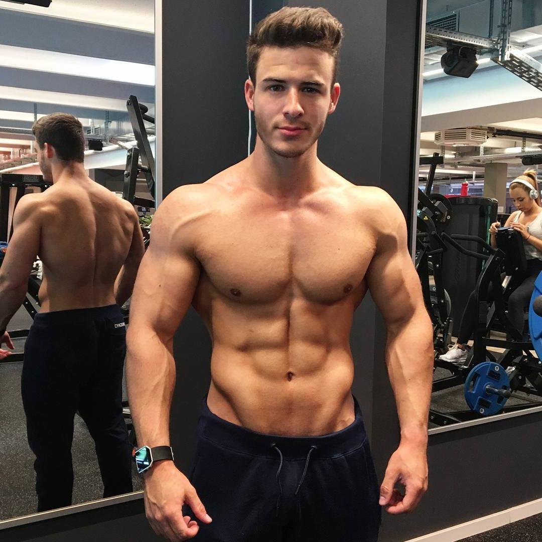 handsome-shirtless-fit-muscle-gym-bodybuilder-wide-shoulders-vline